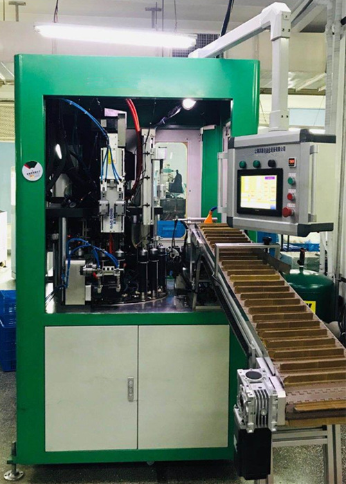 Automatic tube heading machine